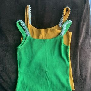 Tops - Tank tops with customized beads around the sleeves